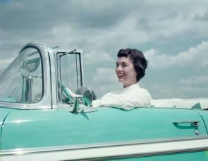 Woman driving 1956 Chevrolet Bel Air Convertible
