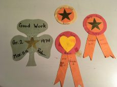 Four of the five badges.
